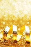 Curly golden serpentine Royalty Free Stock Image