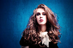 Curly hair. Sensual young woman with curly hair studio shot royalty free stock photos