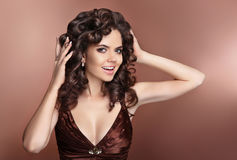 Curly Hair. Attractive laughing brunette girl with healthy curly Royalty Free Stock Image