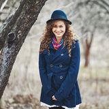 Curly hair beautiful young caucasian girl outdoors Stock Image