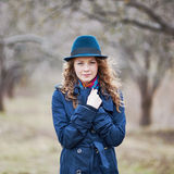 Curly hair beautiful young caucasian girl outdoors Royalty Free Stock Images