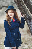 Curly hair beautiful young caucasian girl outdoors Royalty Free Stock Image
