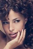 Curly hair beauty. Woman portrait, studio shot, closeup stock images