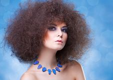 Curly hair and blue make-up Stock Photo
