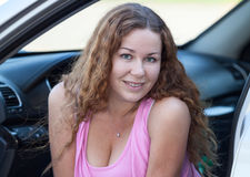 Curly hair Caucasian woman portrait in vehicle, head and shoulder Stock Photography
