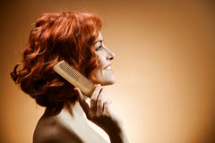 Curly Hair and Comb. Beauty Portrait. Curly Hair and Comb stock photography