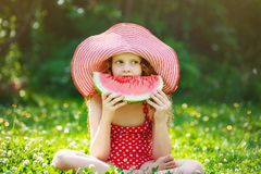 Curly hair Girl eating watermelon Royalty Free Stock Photos