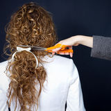 Curly hair and scissor Stock Photos