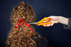 Curly hair and scissor Royalty Free Stock Photography