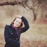 Curly hair spring girl in coat. royalty free stock images