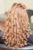 Curly hair styling Stock Photo