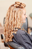 Curly hair styling Royalty Free Stock Photos