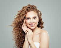 Curly hair woman. Beautiful girl with hatural makeup and long healthy wavy hairstyle stock images