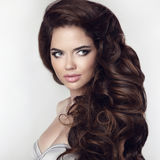Curly hair woman. Healthy hairstyle. Beauty makeup. Closeup port Stock Photos