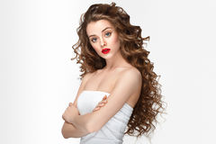 Curly hair woman portrait long hair with perfect make up red lips. Royalty Free Stock Image