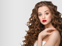Curly hair woman portrait long hair with perfect make up red lips. Stock Images