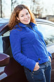 Curly hair woman standing near car Royalty Free Stock Photography