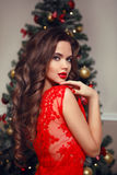 Curly hair. Young beautiful brunette smiling woman model. Makeup Stock Image