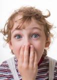 Curly-haired удивленный мальчик стоковые фото