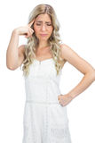 Curly haired blonde having headache Royalty Free Stock Photos