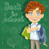 Curly-haired boy with books at the blackboard Royalty Free Stock Images