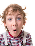 Curly-haired boy surprised Stock Photography