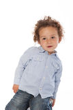Curly Haired Boy Wearing Long Sleeve Shirt stock images