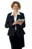 Curly haired corporate woman posing with ipad Royalty Free Stock Photo