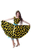 Curly-haired fashionista posing in polka dot dress Royalty Free Stock Photography