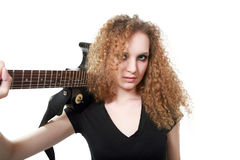 Curly-haired girl with a guitar isolated Royalty Free Stock Images
