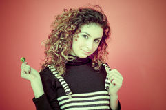 Curly Haired Girl With a Lollipop Royalty Free Stock Images