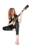 Curly-haired girl playing guitar Stock Image