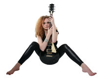 Curly-haired girl sitting with a guitar Royalty Free Stock Image