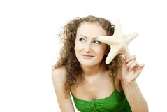 Curly-haired girl with starfish Royalty Free Stock Photography