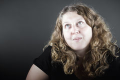 Curly Haired Lady Looking Up Off Camera Stock Photo