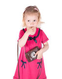Curly-haired little girl with vintage camera isolated Royalty Free Stock Photos