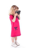 Curly-haired little girl with vintage camera isolated Royalty Free Stock Photo