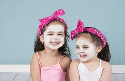 Curly haired little girls in big headbands stock photo