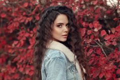 Curly haired Woman autumn outdoor portrait. Young beautiful brun royalty free stock image