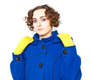 Curly-haired woman in coat Stock Photography