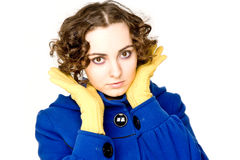 Curly-haired woman in coat Stock Images