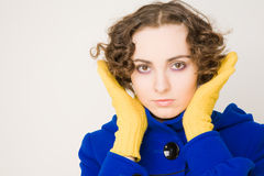 Curly-haired woman in coat Royalty Free Stock Photography