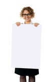 Curly haired woman holding advertising board Royalty Free Stock Image