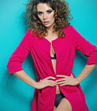 Curly-haired woman wearing pinky coat Stock Photo