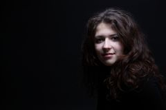 Curly haired young woman portrait Royalty Free Stock Photo