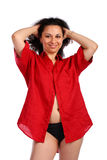 Curly-headed girl in red male shirt posing Royalty Free Stock Photography