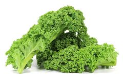 Curly kale. Isolated on white background Royalty Free Stock Photos