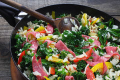 Curly kale with rice and salami Royalty Free Stock Photos