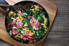 Curly kale with rice and salami Royalty Free Stock Photo