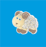 Curly lamb. Picture of a small cute curly lamb on a blue background Royalty Free Stock Photos